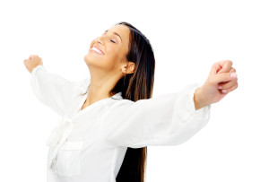 Carefree woman is stress free and holds her arms out for freedom